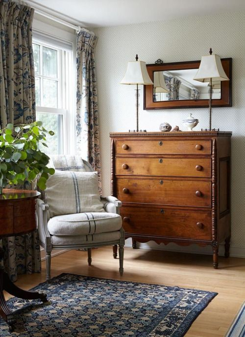 An antique dresser & mirror paired with vintage ticking fabric on the chair.