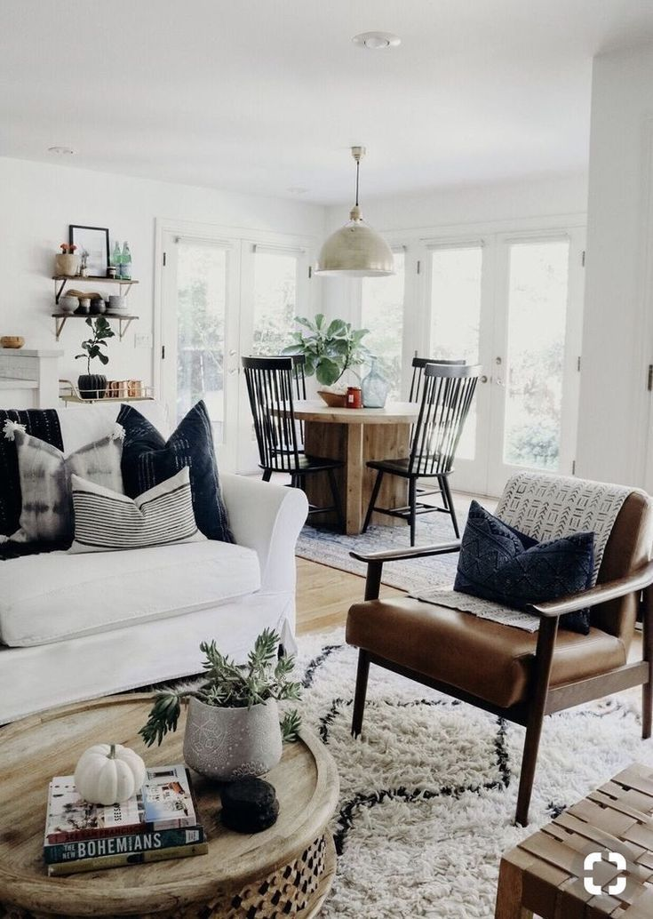 modern boho living room with leather chair and white sofa ...