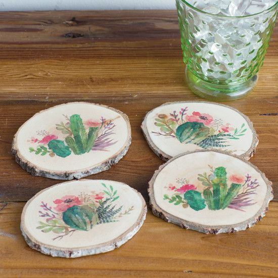 Succulents Coaster Set of 4- Round natural wood coasters feature 4 different blooming cactus images. Each image has a soft, pastel watercolor look.