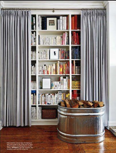 ¿Tapar la librería con unas cortinas?