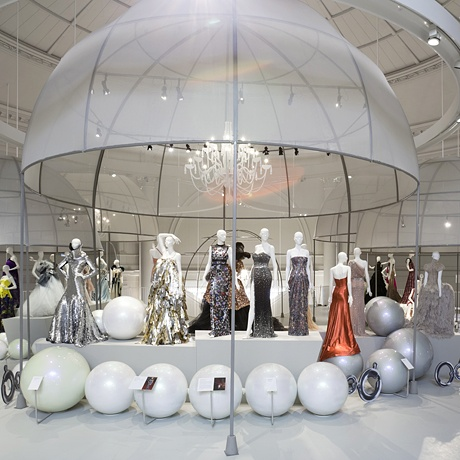 The new Ballgowns exhibition at the V in London celebrates its opening with glamorous frocks from 1950 to current day, including designers from Victor Edelstein and Hardy Amies to Vivienne Westwood and Alexander McQueen. Not to be missed.    The V has just opened a newly refurbished fashion gallery.