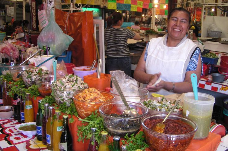 Happy lady making our lunch in Xochimilco, Mexico City, Mexico