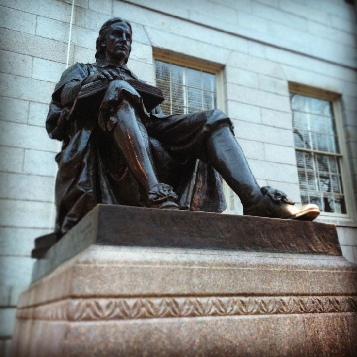 """The John Harvard statue presides over Harvard Yard, just in front of University Hall. You can see the toe of his left shoe is golden - this is because it routinely gets rubbed for good luck! However, this well known Cambridge landmark hides a few truths. In fact, it's known as the """"statue of three lies."""" As Harvard's blog tells us: """"1. That isn't John Harvard...2. John Harvard wasn't the founder of Harvard University...[and] 3. Harvard wasn't founded in 1638."""""""