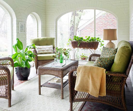 White-painted brick walls and large, arched windows welcome the sunshine in this…