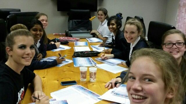 """Another group of WGHS girls helping to write names of less fortunate kids on a shopping list for the """"Love box """" drive"""