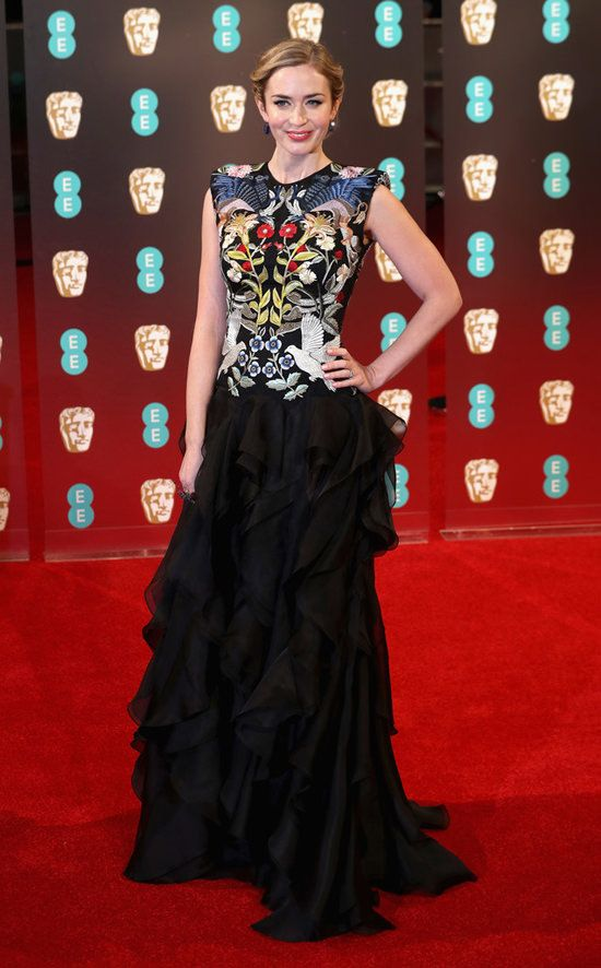 Wow. Love the embroidery work against the black. [Emily Blunt Nails it in Alexander McQueen at the EE British Academy Film Awards   Tom + Lorenzo]