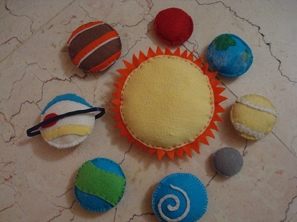 My Felt Solar System that I made for my 20 month toddler to play while she listenning to The Solar System song from They Might be Giants.