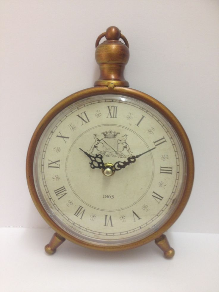 Vintage Style Bronze Effect Mantle Clock £12.99 Vintage style bronze effect mantle clock with dainty legs, has a cream face with black roman numerals and 1863 printed on the face perfect for shabby chic themed rooms. Runs on one AA battery (not supplied), dimensions Approx: H: 22.5cm x W: 16cm x D: 3.5cm