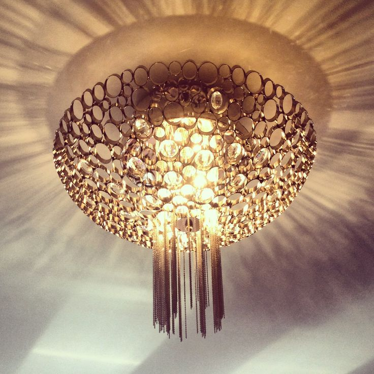 Stunning chandelier that creates just enough drama for the master bedroom