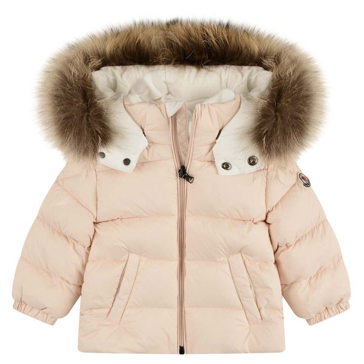 Moncler girls down padded snowsuit in a pink hue. The snowsuit is divided into two parts a zip up coat and a pair salopettes. The zip up top features a featuring a hood with a detachable trim, elasticated cuffs side pockets and a branded silver front zip closure. The salopettes feature an elasticated waistband and the designer's motif to the front. Pink hue Hooded Fur trim Both pieces can be worn separately Down padded 100% Polyamide 90% Goose Down| 10% Feathers Machine wash at 30°