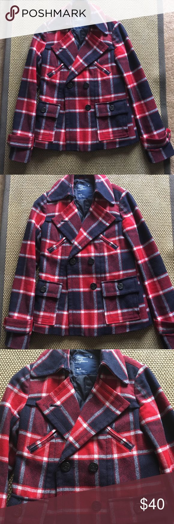 American Eagle Plaid Pea Coat This adorable coat is in very good used condition. Navy, red and white plaid pattern. It has two upper faux pockets and two usable pockets located in the front. She'll is 40% wool 60% rayon. Lining & Filling 100% polyester. Minor piling in wool from normal wear  but not very noticeable at all. American Eagle Outfitters Jackets & Coats Pea Coats
