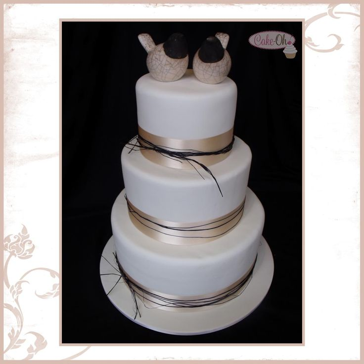 Raffia and Ribbon Rustic Three Tier Wedding Cake with bird cake topper.