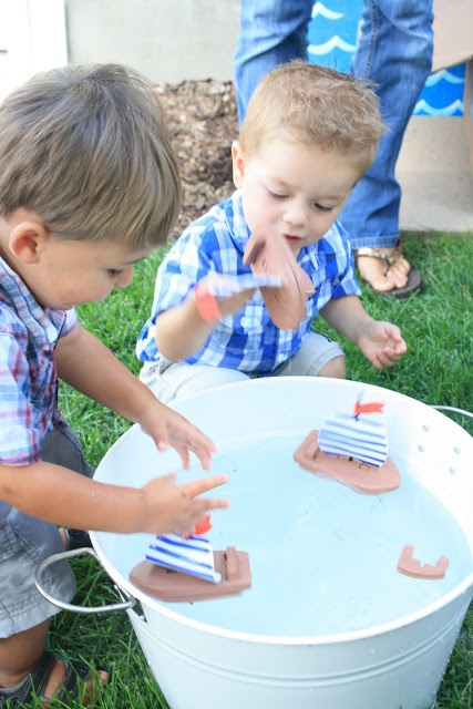 Nautical Birthday Party, games.  Maybe paper boat races that kids use a straw to blow them across a kiddie pool.