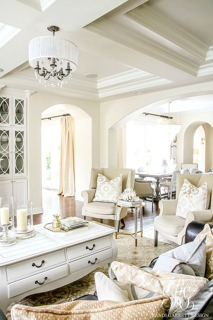 White family room. Pretty chandelier and coffered ceilings. white glass cabinetry and mercury glass candles. Soothing Summer Home Tour 2017 - Neutral Transitional Home Decor