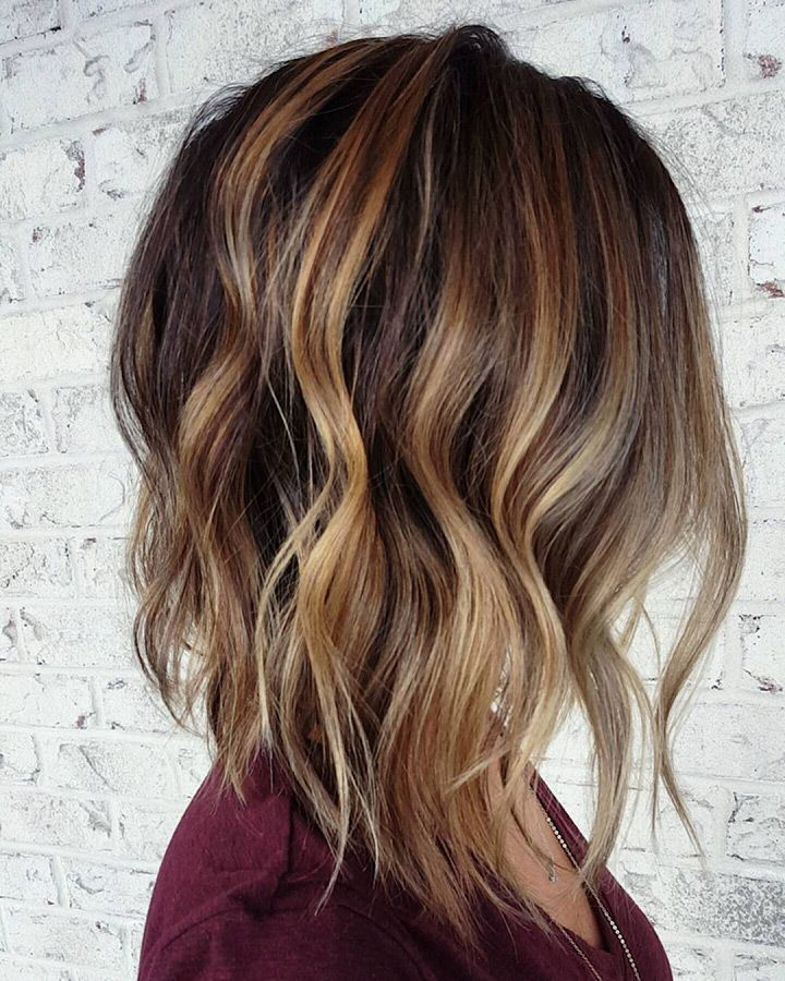 love the balayage highlights on this long version of an inverted bob