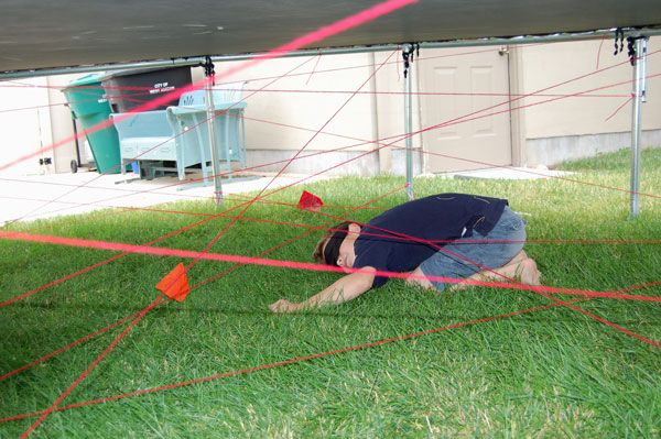 - There was a laser course under the trampoline.  Using red yarn and some flags they had to touch.  This was a huge hit.  The boys did it over and over again.