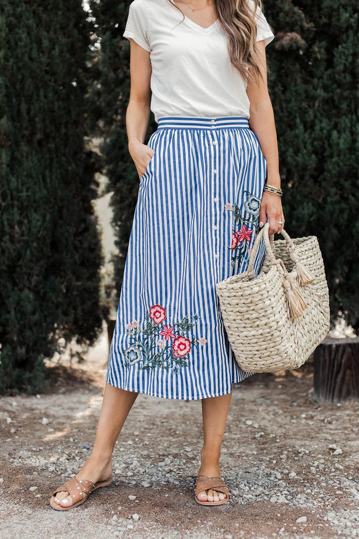 A simple t-shirt and fun midi skirt make a perfect summer outfit that feels effortless, polished, and still semi casual. Try this combo in your closet!