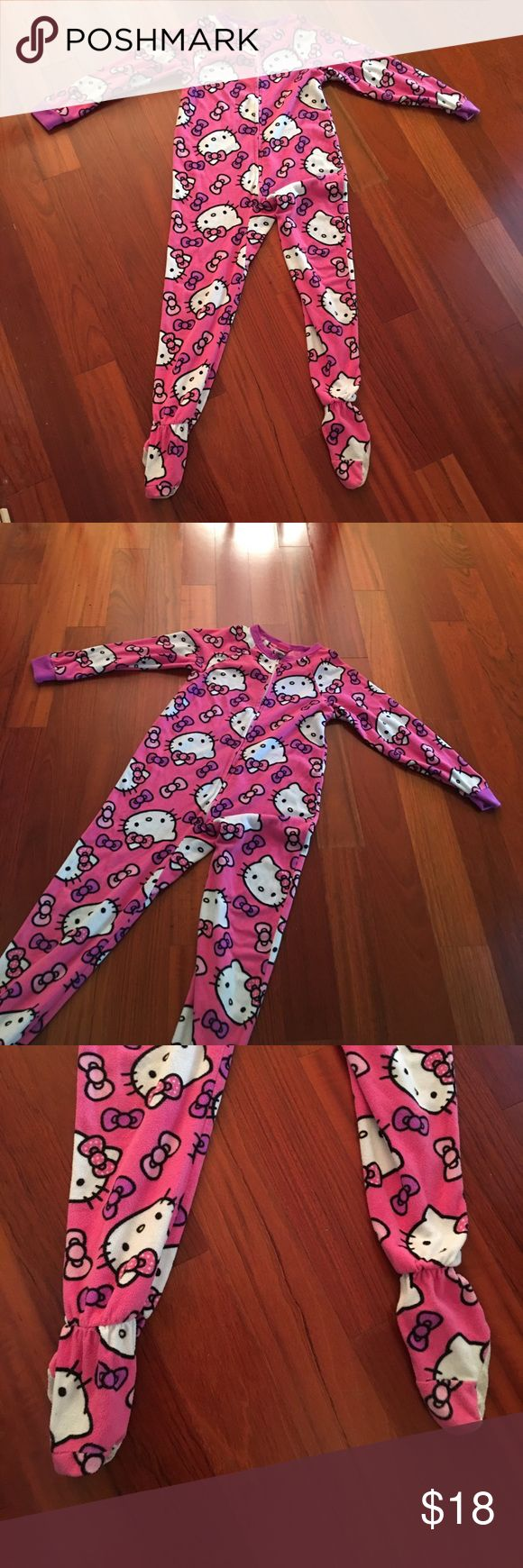 Hello Kitty onesie pajama outfit size 8 Hello Kitty onesie pajama outfit zip up front. Size 8 in little girls clothing. EUC only wear is minimal to the feet. In excellent preloved condition. Flannel material very warm. Offers welcome and all purchases receive free gift 🎁! Get it while you can this will sell quickly. Hello Kitty Pajamas
