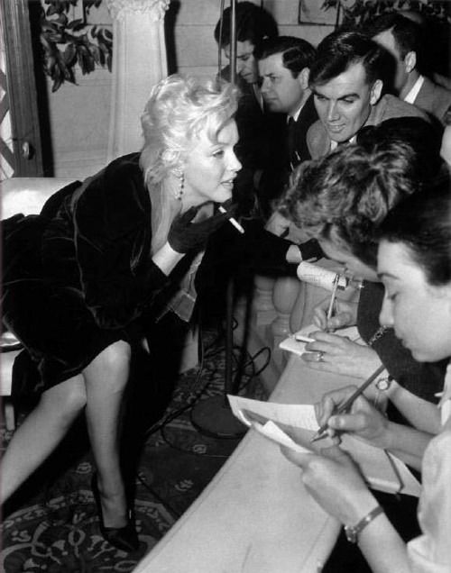 Marilyn Monroe at a press conference for The Prince and The Showgirl © Eve Arnold, 1956.