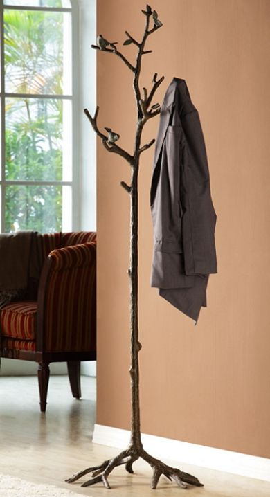Lovebirds Coat Rack -Rustic, decorative coat rack with a sculptured tall tree trunk and several protruding branches that serve as garment holders. The tree branches have two small Love Birds perching on different levels and the coat rack has a free standing base composed of a system of several roots that flare out for stability. The coat rack sculpture has been treated with a lustrous bronze color patina that has been applied by hand and thoroughly polished.