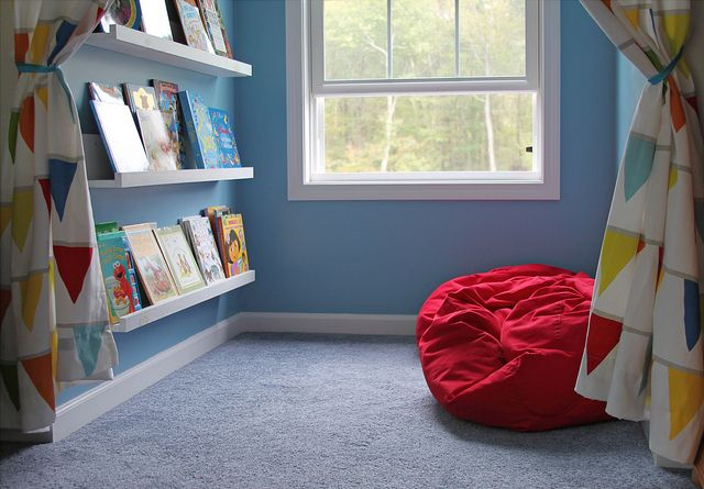 A reading corner - perfect for a study room. I like the beanbag or other comfy chair for kids to sink into while they read - also, interesting bookshelf idea
