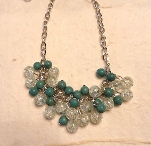 """This chic necklace was carefully handcrafted into a piece of art to be worn on the town or for an evening dinner.  Each bead was individually set and placed on to a dazzling silver chain.  The teal beads have a rustic-cracked earth look, while the glass beads resemble frozen water.  This necklace measure out to 11"""" in length and 22"""" around.    Beautiful for any occasion!"""