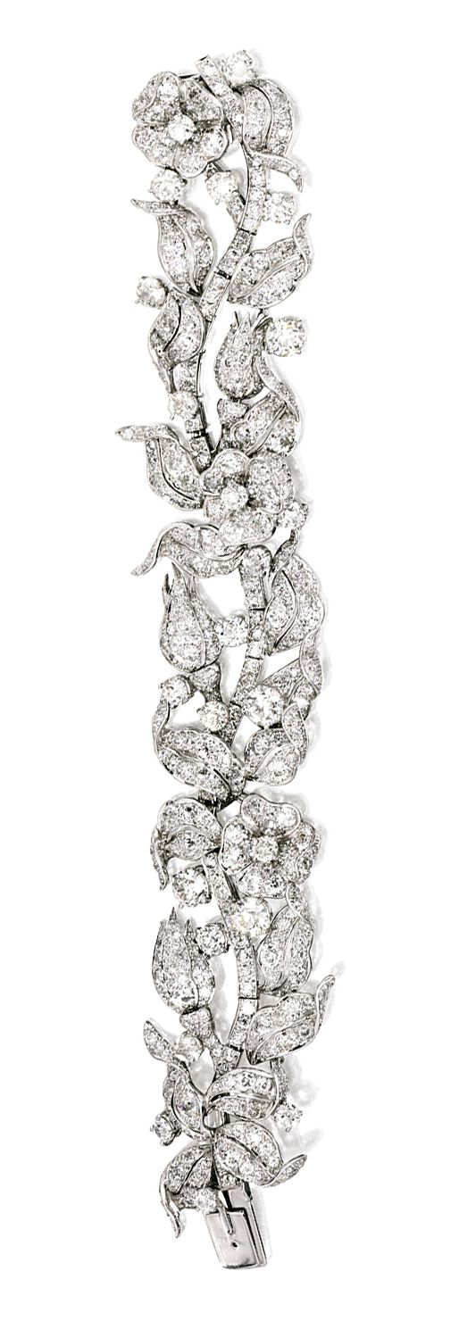 A PLATINUM AND DIAMOND 'LEAF AND FLOWER' BRACELET, VERDURA, 1954 designed as a meandering flowering vine, set with numerous old mine and old European-cut diamonds weighing approximately 25.00 carats, length 6½ inches, unsigned; with fitted and signed box.