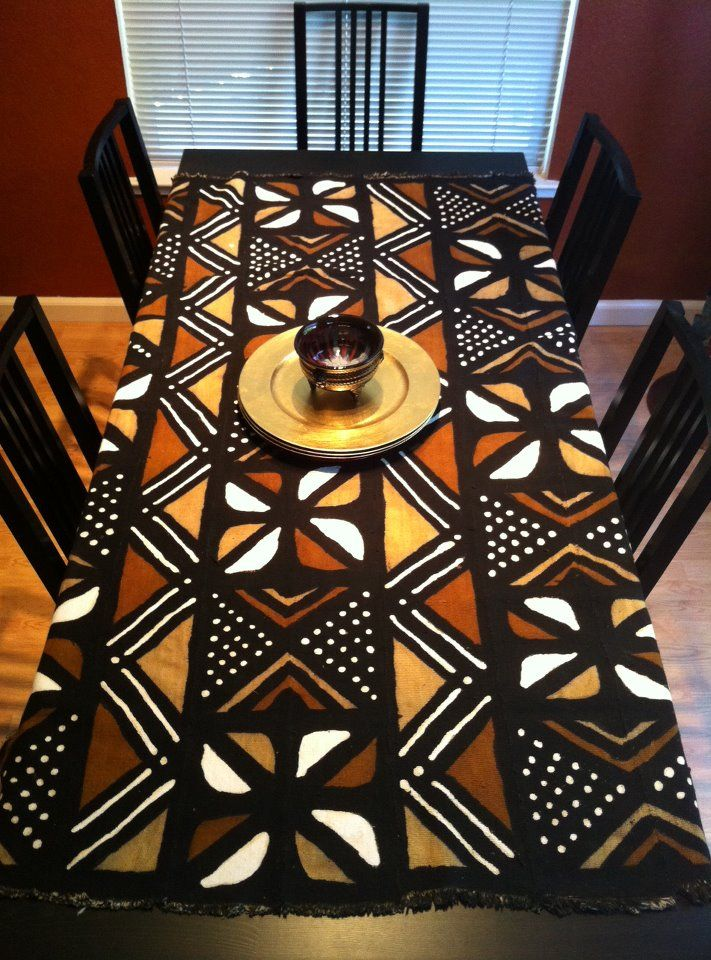 A hand dyed mud cloth used as a table cloth. Handmade using an all-natural dying process in Mali, west Africa.
