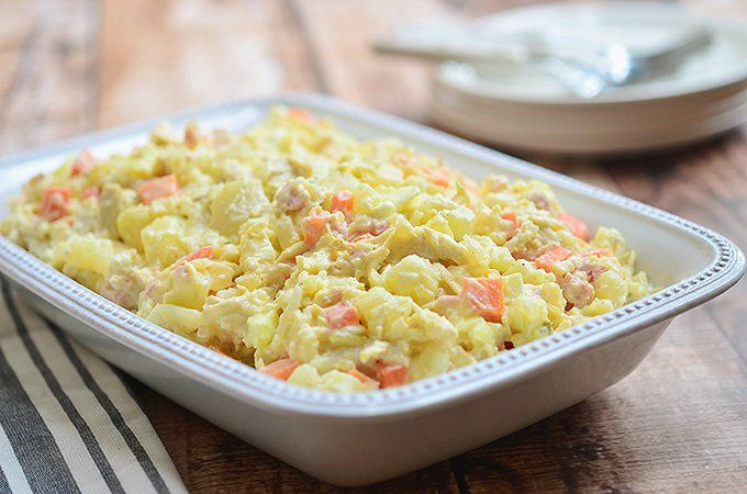 Chicken Potato Salad-Chock-full of shredded chicken, crushed pineapple, cubed ham and diced carrots, this potato salad is a definite crowd pleaser.