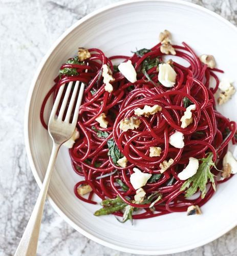 Felicity Cloake's recipe for beetroot noodles with goat's cheese, toasted walnuts and baby kale from The A-Z of Eating can be made by cooking the pasta in beetroot juice. The process turns the noddles a shocking pink colour and gives them a sticky vegetable sweetness which works particularly well with creamy, lactic goat's cheese and bitter toasted walnuts. Quick, easy and delicious.
