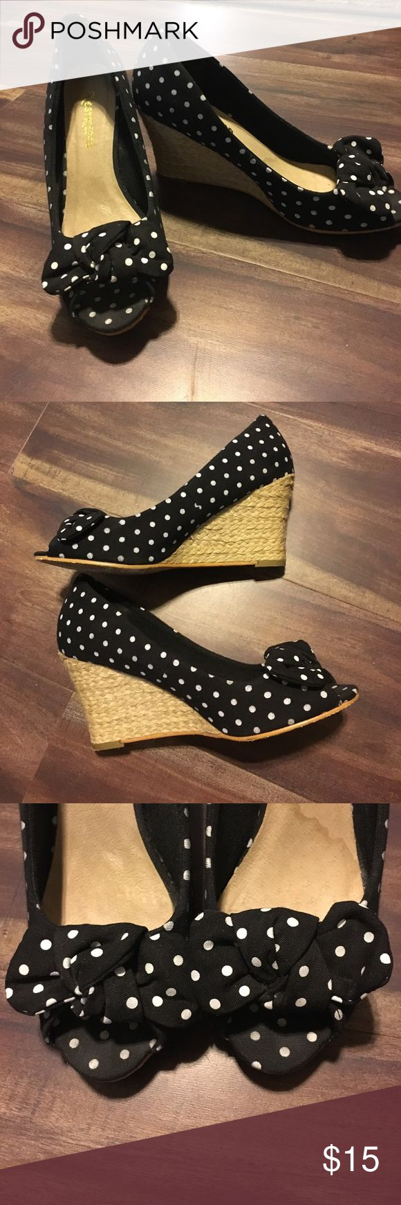 B&W Polka dot wedge, size 7 Black and white Restricted polka dot wedge sandal with knot bows on toe. Worn a couple of times but still in great condition. *Left shoe on inside leather has a water mark line. Restricted Shoes Wedges