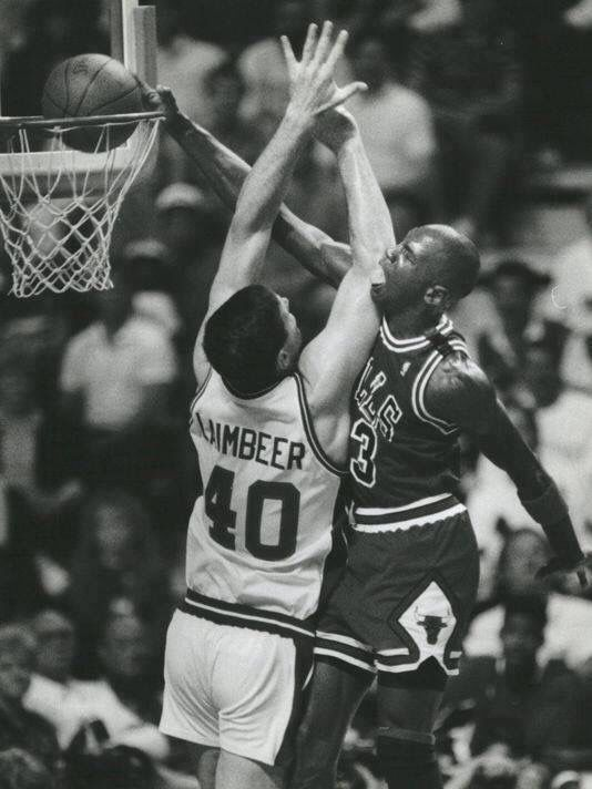 Michael Jordan dunking on Bill Lambeer!!