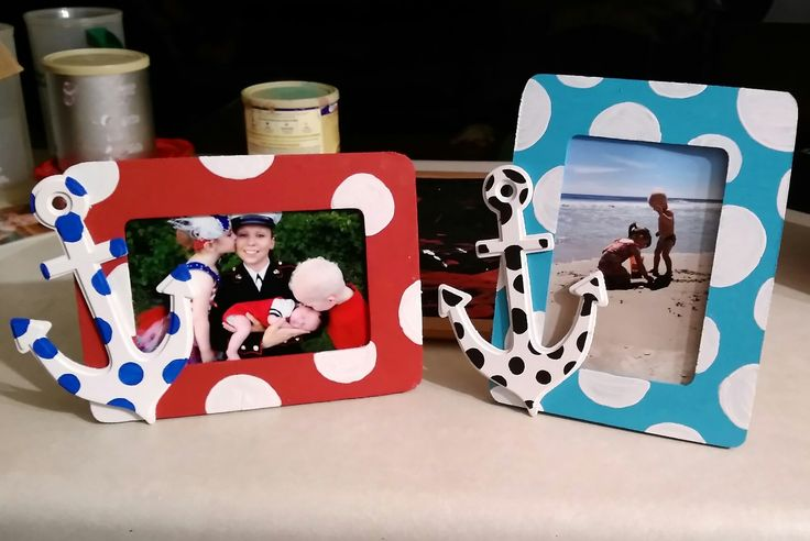 DIY Anchor picture frame . dollar store frames , with wooden anchors attached