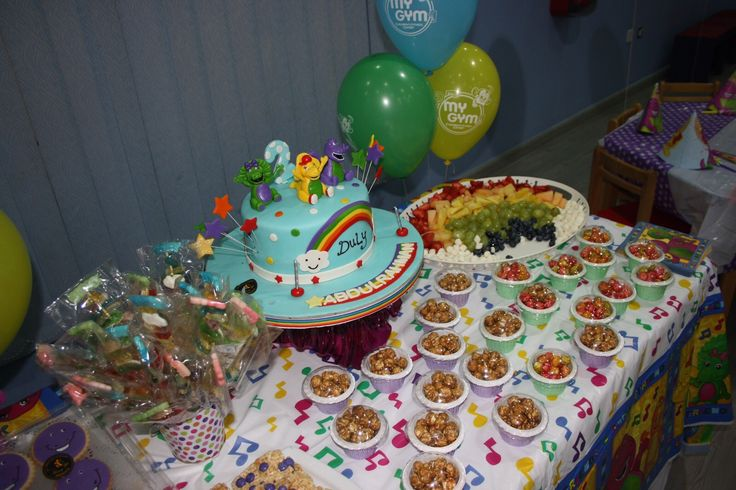 #birthdayparty #birthdaycake #birthday #barney #rainbow #popcorn #candy skewers #ricekrispietreats