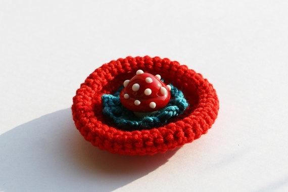 Crocheted mushroom lampwork glass brooch by evasmidt on Etsy, $25.00
