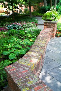 Brick coping tops the curvilinear garden wall