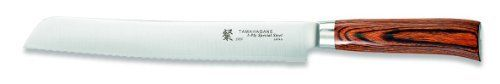 Tamahagane San SN-1118H - 10 inch, 240mm Bread Knife by Tamahagane. $161.95. 10-inch bread knife with serrated edge blends modern construction techniques with Japanese knifemaking traditions. Balanced with a stainless steel weight that attaches to the tang. Hand wash only; limited lifetime warranty; made in Japan. Exceptionally sharp edge thanks to thin VG5 steel core sandwiched between layers of SUS410 steel for stain resistance. Distinctive, comfortable handle ma...