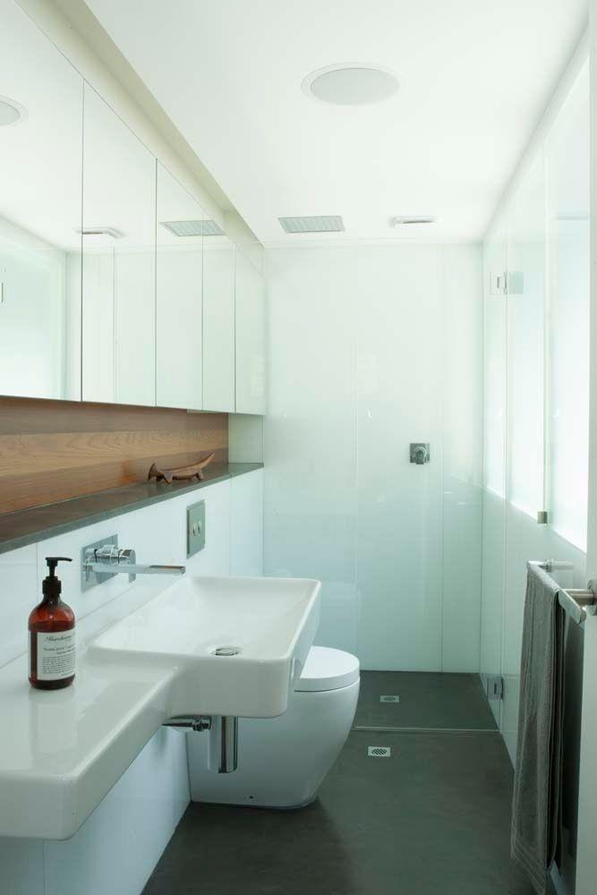 Master ensuite with Zenolite panelling and concrete floor. Brooke Aitken Design.