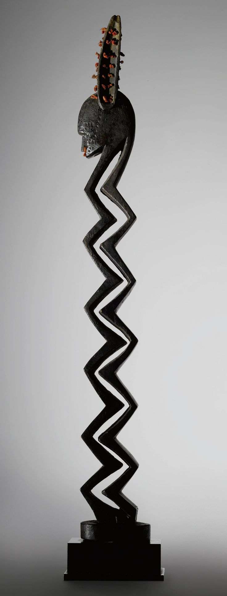 Africa | Zigzag figure from the Bamana people of Mali | Wood and red cord | Sold by Sotheby's on the 11th of May 2012 for 2,658,500$