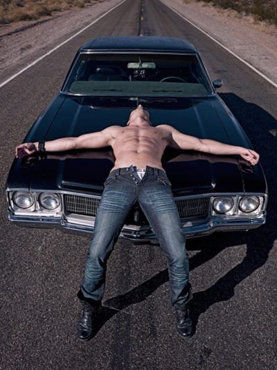 That is just a perfect picture...black 67 Impala and half naked Jensen Ackles