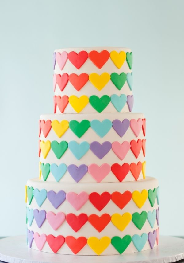 Rows of fondant rainbow hearts applied very carefully to maintain the pattern!