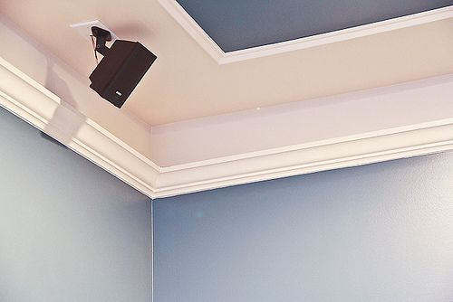 Faux moulding mixed with moulding, and ceiling color a deeper hue of wall color create a faux tray ceiling.