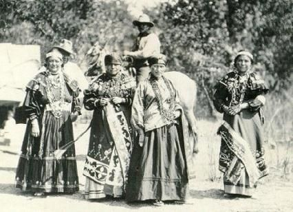 Texas Kickapoo Indian women in traditional dresses around 1900.