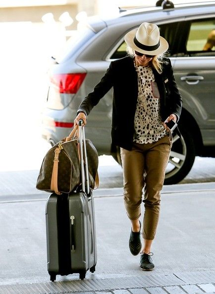 Naomi Watts arrives at LAX with her Louis Vuitton Keepall duffle bag.