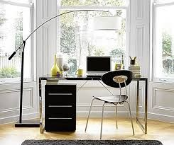 in front of the window is kind of nice… floating in space, no need for the file cabinet, but love the floor lamp.