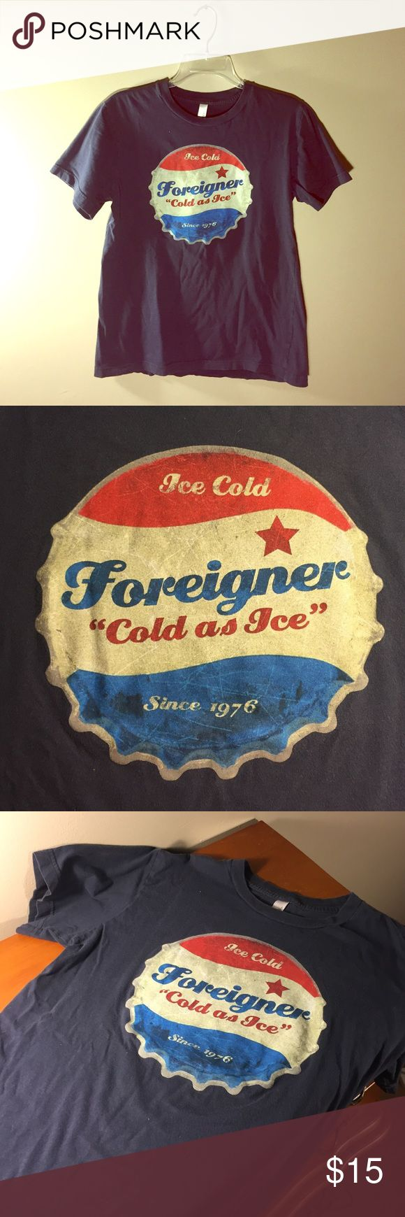 2014 Foreigner Concert T-shirt A t-shirt purchased from a Foreigner concert in 2014. WARNING: shirt runs kinda small imo so if you're a larger medium I wouldn't risk it :) Shirts Tees - Short Sleeve
