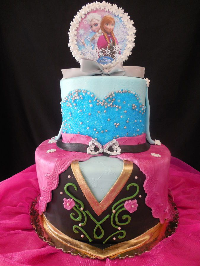 DISNEY'S FROZEN ANNA AND ELSA 2D FONDANT GOWN CAKES. ELSA'S CAKE WAS MADE IN BUTTERCREAM AND COVERED IN SUGAR CRYSTALS