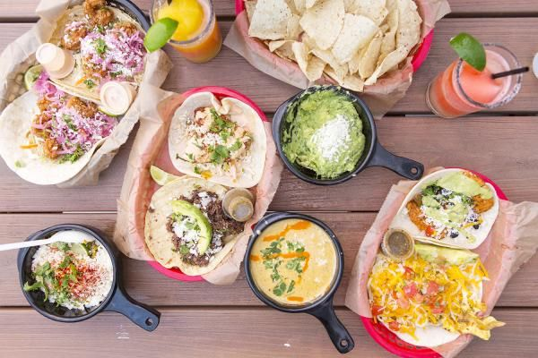 Table spread at Torchys including tacos chips guacamole and queso