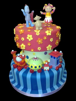 Ninky Nonk, Makka Pakka, Upsy Daisy and Iggle Piggle adorn this wonderfully bright coloured, two tier cake. Be the mum with the cake that gets remembered at their kids party, for all of the right reasons