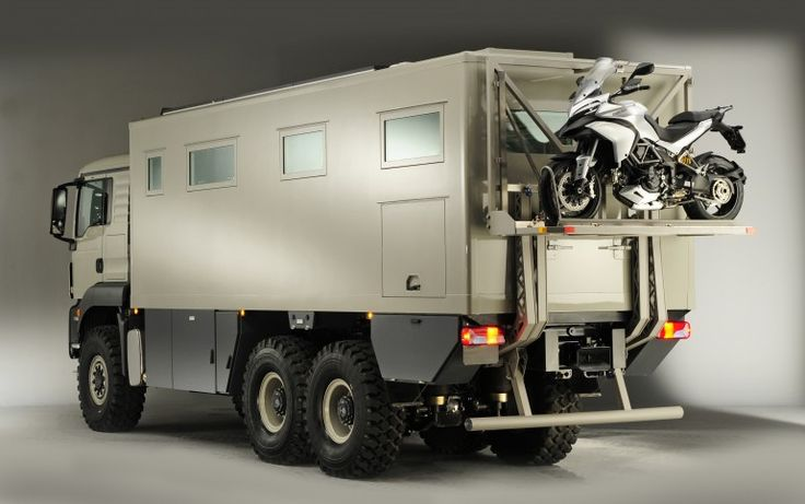 Global XRS 7200 6X6 Expedition Truck - A rear lift makes it easy to carry and access a bike